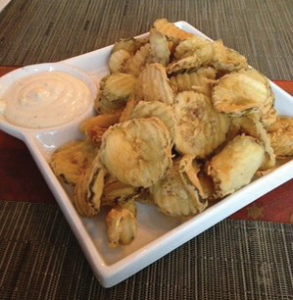 COURTESY YELP Scion serves up contemporary American dishes with a twist, including their fried pickles with a yogurt and dill sauce.