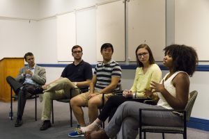 "ALEXANDER BROWN/THE HOYA Evan Hollander (SFS '14), Nate Tisa (SFS '14), Kyle Zhu (SFS '14), Lizzy MacGill (COL '14) and Aya Waller-Bey (COL '14) talk at ""Georgetown in FIve Years: A Conversation With Student Leaders."""