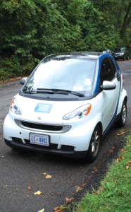 DAVID WANG FOR THE HOYA Several car2go vehicles are available for hire around Georgetown's campus.