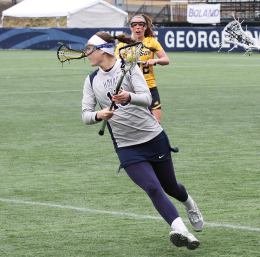 FILE PHOTO: ALEXANDER BROWN/THE HOYA Junior midfielder Meghan Farrell excelled Saturday, recording three goals. Despite Farrell's efforts, No. 10 Georgetown fell 17-11 to No. 3 North Carolina.