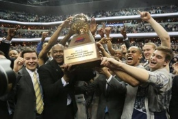 CHRIS BIEN/THE HOYA Head Coach John Thompson III and the Georgetown men's basketball team celebrate after winning a share of the Big East regular season title. The Hoyas will be the No. 1 seed in the conference tournament.
