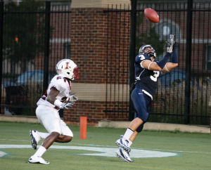 CHRIS BIEN/THE HOYA Junior slot receiver Max Waizenegger catches the first of two touchdown passes in the Hoyas' 14-13 win Saturday night.
