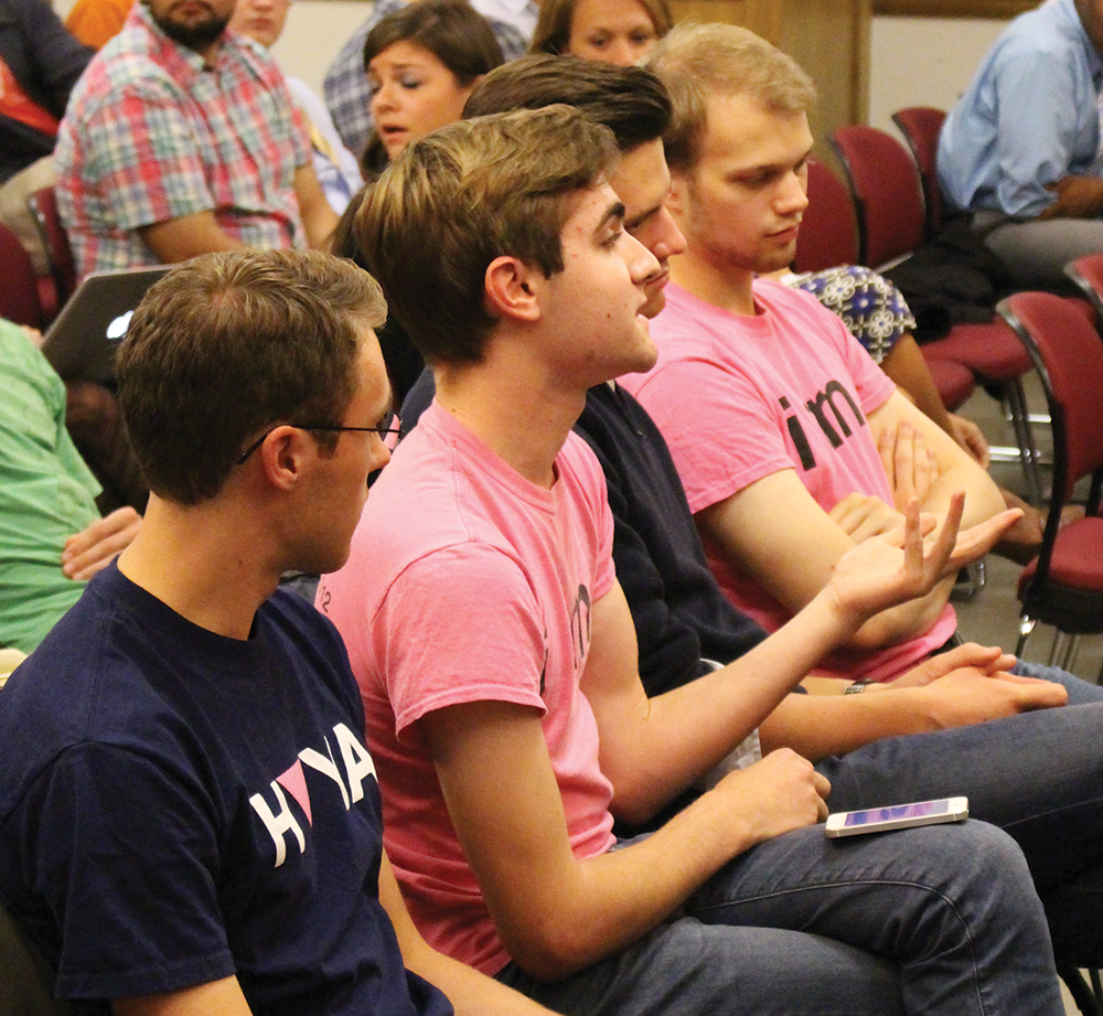 GU Pride President Thomas Lloyd (SFS '15), second from left, questioned Love Saxa speaker Ryan Anderson on Tuesday. DANIEL SMITH FOR THE HOYA