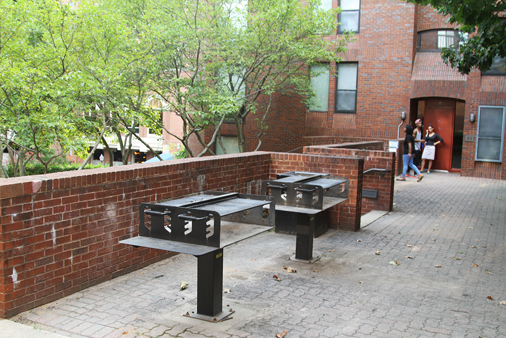 CHRIS GRIVAS/THE HOYA Students of legal age will now be permitted to consume wine and beer outside in the grill area of Henle Village as part of a pilot program beginning today.