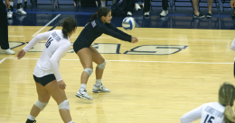 FILE PHOTO: CHRIS GRIVAS/THE HOYA Sophomore libero MacKenzie Simpson (in blue) recorded a total of 36 digs in two games last weekend.
