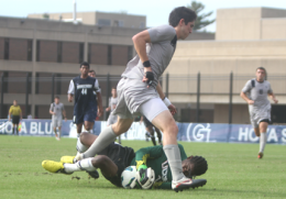 CHRIS GRIVAS/THE HOYA Senior Andy Riemer (in gray, foreground) scored in the 65th minute, but UConn's Andre Blake (in green) came up big with seven save