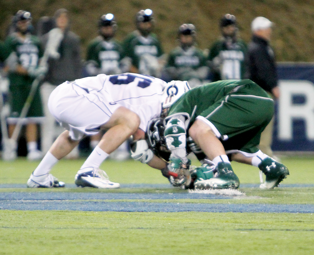 CHRIS GRIVAS/THE HOYA Redshirt junior defender Tyler Knarr continued his outstanding play Wednesday, going 8-for-10 on faceoffs in Georgetown's 13-8 loss to 2012 national champion Loyola
