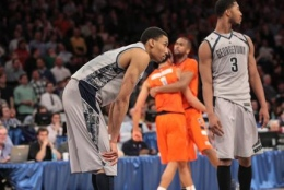 CHRIS BIEN/THE HOYA Otto Porter Jr. and Mikael Hopkins look on in disbelief after the top-seeded Hoyas' early exit.