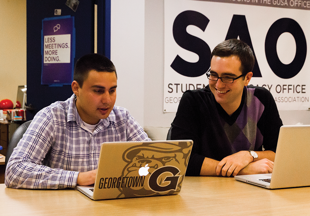 GUSA Vice President Adam Ramadan (SFS '14), left, and President Nate Tisa (SFS '14) meet in their office midway through their yearlong term. ALEXANDER BROWN/THE HOYA