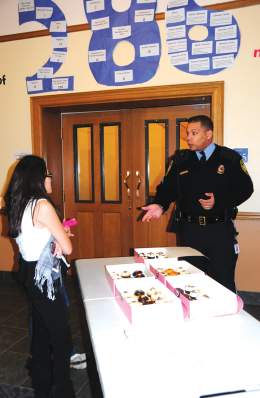 Department of Public Safety officer Sgt. Adrian Black answered questions and registered possessions in McCarthy last week.