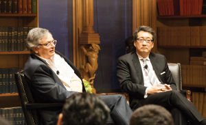 MICHELLE XU/THE HOYA Columnist and author Moisés Naím (left) and Director of Asian Studies Victor Cha (right) discuss the nature of power in a chaotic world in Riggs Library on Monday evening.