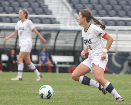 FILE PHOTO: CHRIS GRIVAS/THE HOYA Senior defender Christina O'Tousa (foreground) set up the Hoyas' first goal against South Florida in a game ultimately won on penalty kicks.