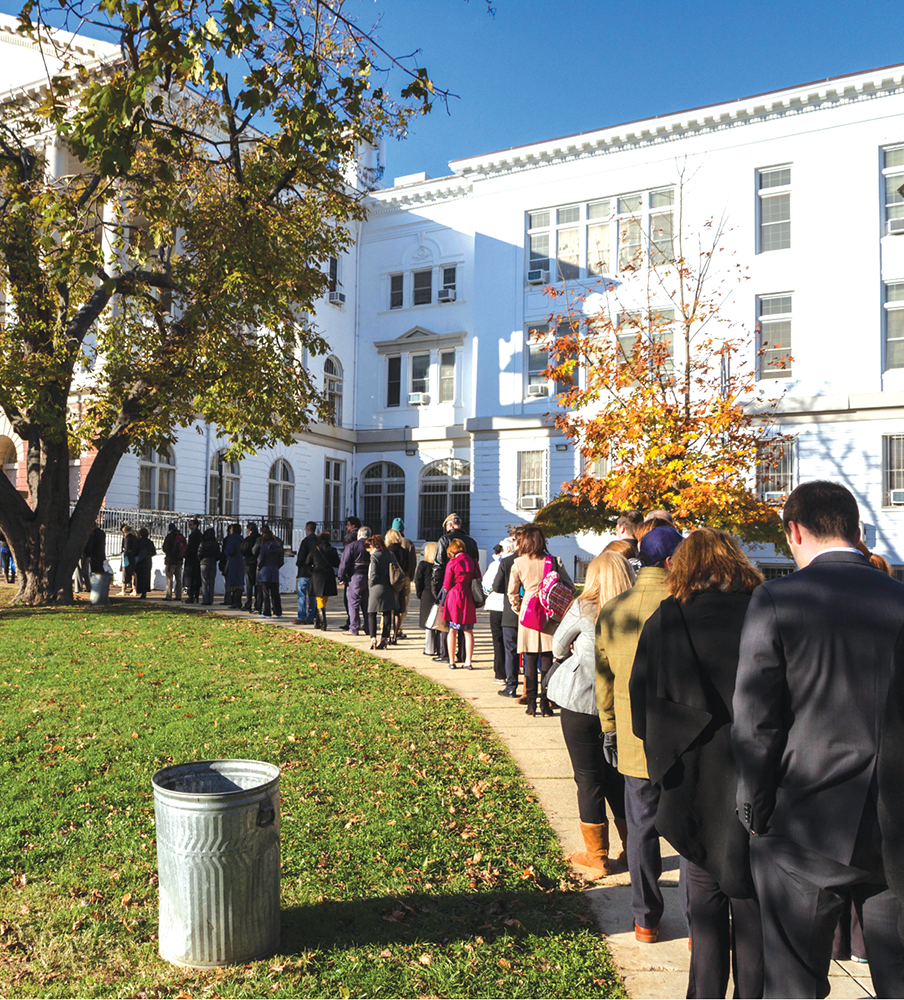 ALEXANDER BROWN/THE HOYA Redistricting could affect assignment of polling places, like Duke Ellington School, seen here on Election Day in November 2012.