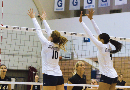 ALEXANDER BROWN/THE HOYA Redshirt sophomore outside hitter Elizabeth Riggins (10) and sophomore middle blocker Dani White (9) combined for 20 kills in Georgetown's straight-set victory over DePaul Sunday.
