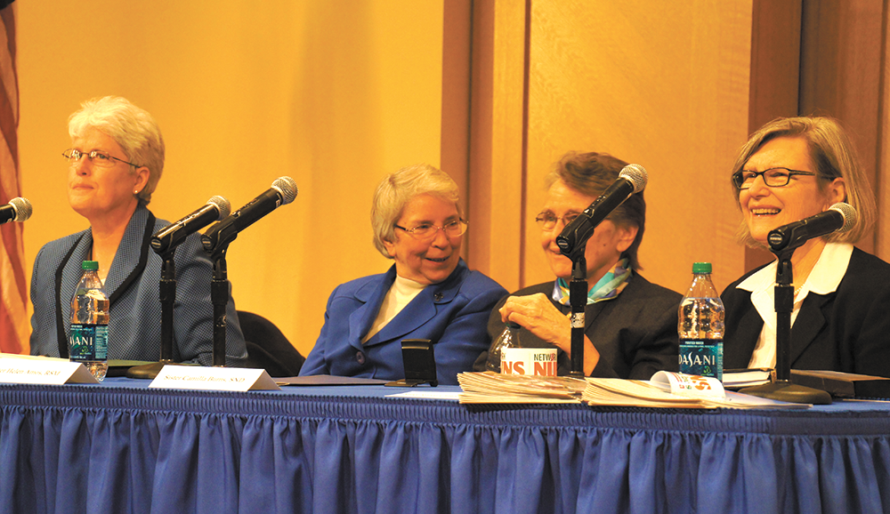 CLAIRE SOISSON/THE HOYA From left: Sisters Mary Johnson, Helen Amos, Camilla Burns and Simone Campbell lead a panel discussion Friday on the ways Vatican II changed the Catholic Church.