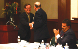 Peter Prindiville, who is running to represent district 8 on ANC 2E, shakes hands with Chair Ron Lewis after being introduced Wednesday.