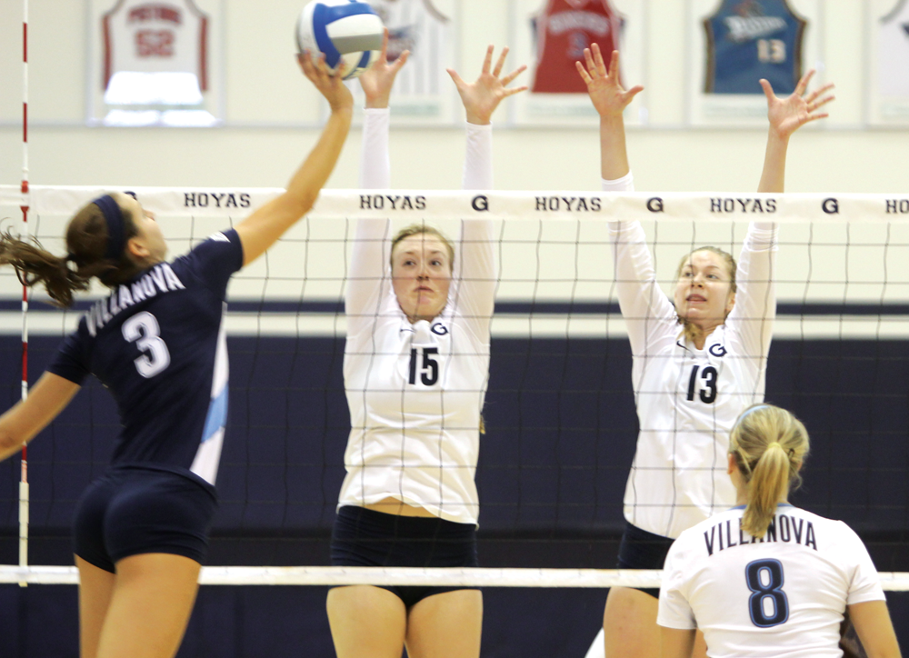 FILE PHOTO: CHRIS GRIVAS/THE HOYA Senior middle blocker Lindsay Wise (13), shown here against Villanova, had 10 kills — including five in the fourth set — against South Florida Sunday.