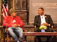 DANIEL SMITH/THE HOYA Rapper Nas, left, discusses the legitimacy of hip-hop in academia with professor James Braxton Peterson on Thursday in Gaston Hall.