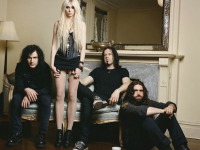 """REVOLVERMAG The Pretty Reckless' new album, """"Going to Hell,"""" shows obvious improvement and development compared to the group's previous work."""