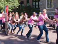"""MICHELLE XU/THE HOYA GU Pride members wear T-shirts reading """"I am"""" and walk through a door in Red Square in celebration of National Coming Out Day on Oct. 11."""