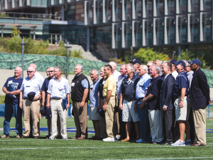 JULIA HENNRIKUS/THE HOYA Members of the 1964 Georgetown football team gathered at midfield of the MultiSport Facility during halftime of Georgetown's 17-3 win over Brown. The Hoya alumni were honored for their contribution to the program.
