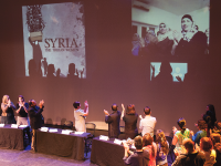 """MICHELLE XU/THE HOYA The refugees who originally planned to visit Georgetown, spoke to attendees via Skype at """"Voices Unheard — The Syria: Trojan Women Summit."""""""