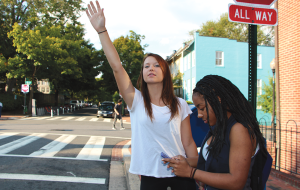 CLAIRE SOISSON/THEHOYA McKenzie Schwarze (NHS '17) and Alexis Campbell (COL '17) hail a cab outside the front gates. Hailo, a new cab-hailing app, offers riders a 50 percent discount on weekday taxi rides.