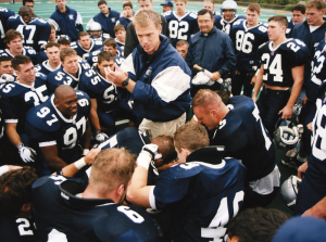 COURTESY GEORGETOWN UNIVERSITY ARCHIVES Coach Bob Benson with the team in 1997.