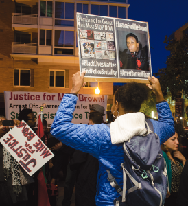 DAN GANNON FOR THE HOYA Georgetown students joined hundreds of marchers who stopped traffic on M Street and Wisconsin Avenue in a protest of events in Ferguson, Mo.