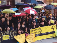 TOBY HUNG FOR THE HOYA Protesters supporting Hong Kong demonstrators rallied outside the Hong Kong Economic and Trade Office on Wednesday.