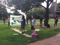 EMMA HINCHLIFFE/THE HOYA Students protested a lecture by IMF Managing Director Christine  Lagarde with a live-action board game in Healy Circle.