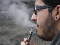 FILE PHOTO: DANIEL SMITH/THE HOYA Juan Luis Tirado (COL '16) smokes an e-cigarette. In their report, Cobb and Abrams called for FDA approval of e-cigarettes.