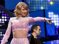 """MUSIC TIMES Taylor Swift's new album """"1989"""" has completely departed from her country origins, showcasing instead her talent as a successful pop singer."""