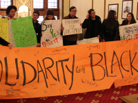 NATASHA THOMSON/THE HOYA GU Fossil Free marched to President John J. DeGioia's office on Friday.