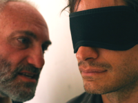 "Courtesy Nasser Kalaji Kim Bodnia as the interrogator and Gael García Bernal as Maziar Bahari in Jon Stewart's directorial debut ""Rosewater"" about Bahari's experience."