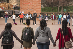 ISABEL BINAMIRA/THE HOYA More than 75 students protested the Ferguson decision in Red Square.