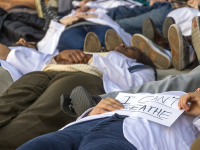 DANIEL SMITH/THE HOYA Georgetown University Medical Center students performed a die-in outside of the hospital today.