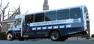 COURTESY GEORGETOWN UNIVERSITY The Office of Facilities Management announced the addition of 16 new GUTS buses to the university's current fleet. The buses feature a student-made and student-chosen design that incorporates silhouettes of Georgetown and D.C.