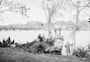 LIBRARY OF CONGRESS An unidentified group of Civil War soldiers look across the Potomac River to the simple landscape of Georgetown's campus.