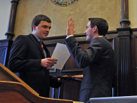 VALERIA BALZA/THE HOYA Outgoing GUSA President Trevor Tezel (SFS '15) swore in incoming President Joe Luther (COL '16) in Saturday's ceremony. Luther will serve alongside Vice President Connor Rohan (COL '16).