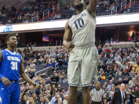MICHELLE XU/THE HOYA Senior center Tyler Adams joined the Hoyas on the court for the first time since Dec. 2011 and scored the opening basket on Georgetown's Senior Day.