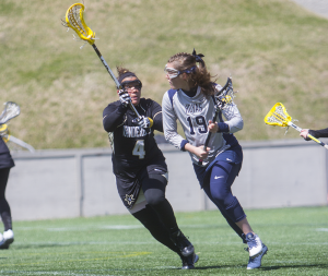 FILE PHOTO: JULIA HENNRIKUS/THE HOYA Senior attack Caroline Tarzian scored two goals in Georgetown's 8-7 win over Marquette on Saturday. Junior attack Corinne Etchison and junior midfielder Kristen Bendos also scored a pair of goals apiece.