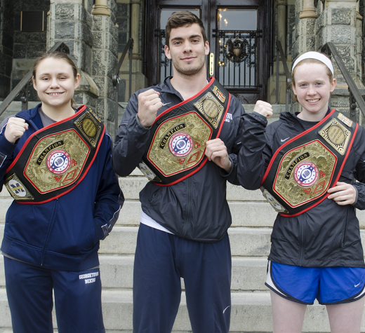 DAN GANNON/THE HOYA Sophomore Corrina Di Pirro, left, junior Mike Minahan, center, and sophomore Sinead Schenk each earned an individual title belt at the USIBA National Championships to lead Georgetown's club boxing team.