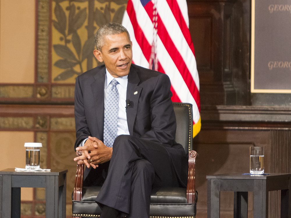 CHRIS GRIVAS/THE HOYA President Barack Obama discussed the cost of poverty in Gaston Hall on Tuesday.