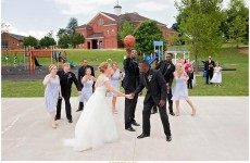 Meredith Cox Crawford and Tyler Crawford line up for a jump ball on their wedding day.