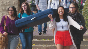 FILE PHOTO: MICHELLE XU/THE HOYA Student activists, including author Zoe Dobkin (SFS '16), back left, carry a mattress during October's Carry the Weight event, a day of sexual assault awareness at college campuses across the country.