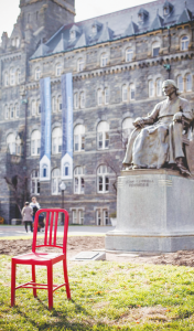 COURTESY CHARLIE LONG The university placed a red chair in Healy Circle this past spring to symbolize the seat women should take in technology development.