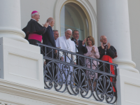DAN KREYTAK FOR THE HOYA Pope Francis appears on the Capitol balcony Thursday morning following his speech to a joint session of Congress. Tens of thousands gathered on the West Lawn to await the pontiff, flanked by Vice President Joe Biden, Speaker John Boehner (R-Ohio), House Minority Leader Nancy Pelosi (D-Calif.) and clergy.