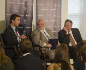 JOHN CURRAN FOR THE HOYA Luis Fortuño (R-Puerto Rico), John Carr and Tim Kaine (D-Va.) discussed the pope's address to Congress in McCarthy Hall on Friday.