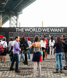 "THE WORLD WE WANT Residents and tourists in New York City signed the first ""The World We Want Wall"" last Sept. The art installation comes to Washington, D.C. this Friday."